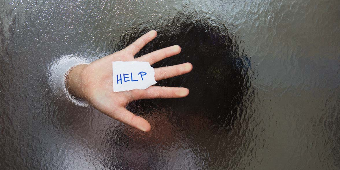 Photo of someone with help written on their hand