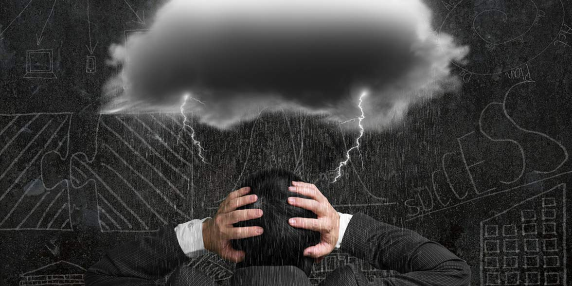 Photo of a storm cloud over a man's head