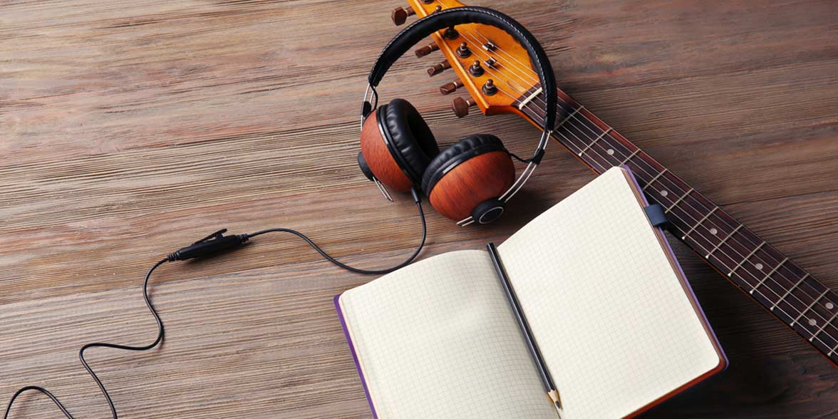 Photo of headphones and a guitar