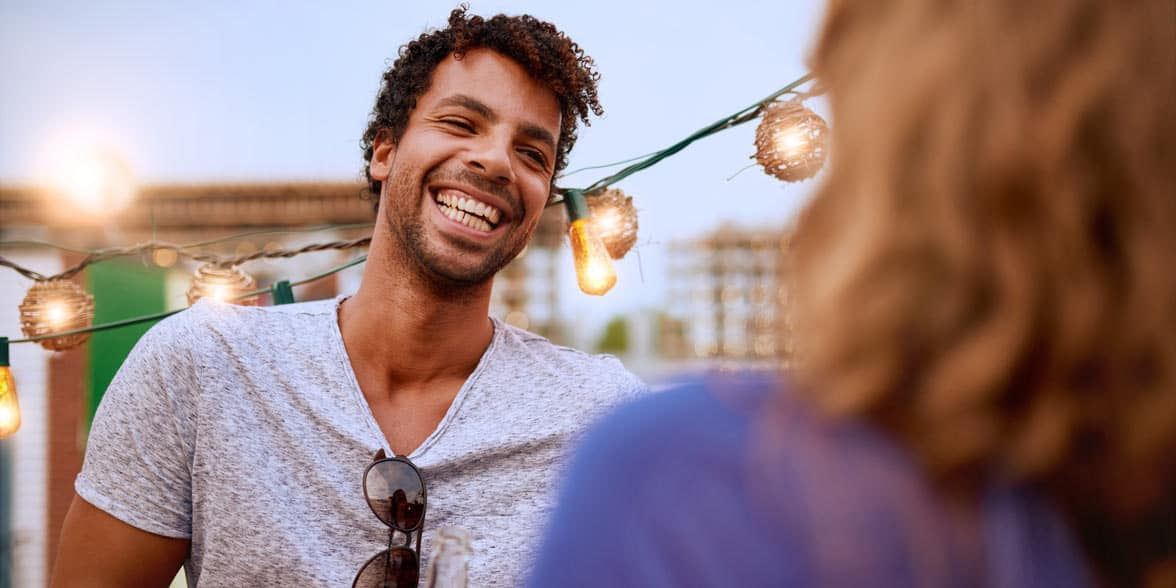 Photo of a man talking and smiling