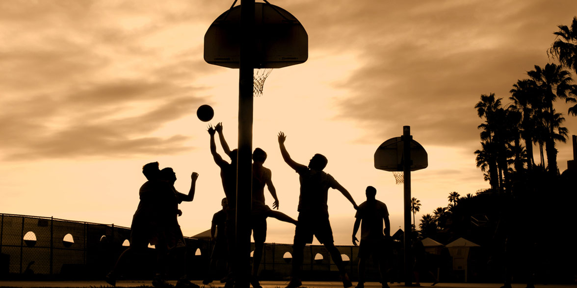 Photo of people playing basketball