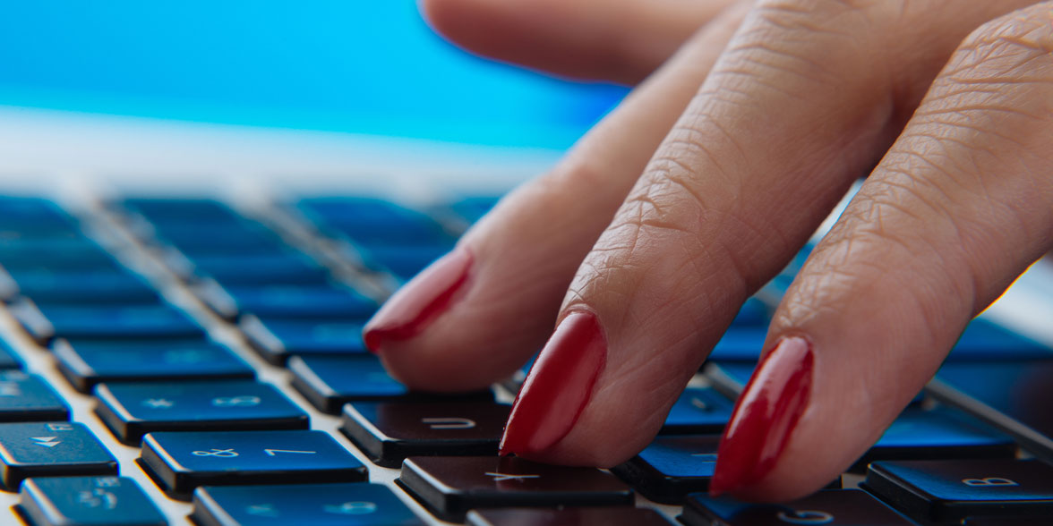 Photo of fingers on a keyboard