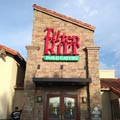 Tilted Kilt Pub and Eatery Logo