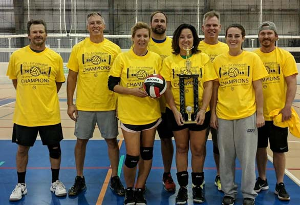 Photo of a coed volleyball team in Worcester