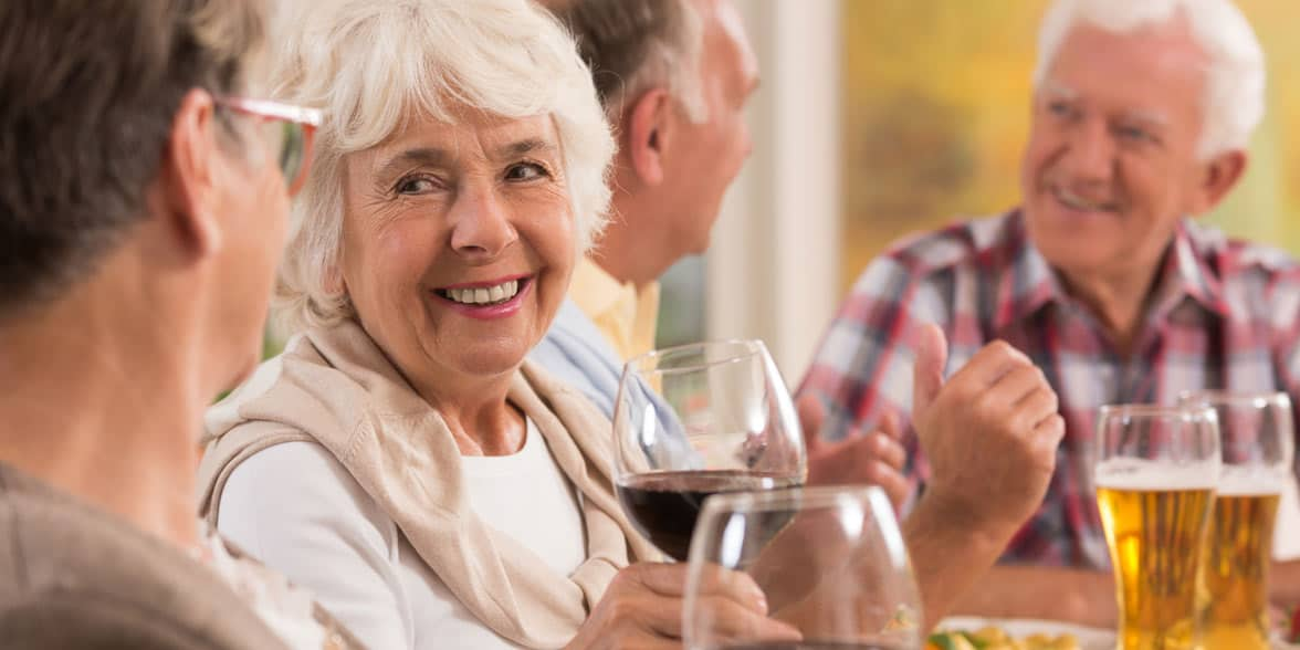 Photo of older women drinking wine