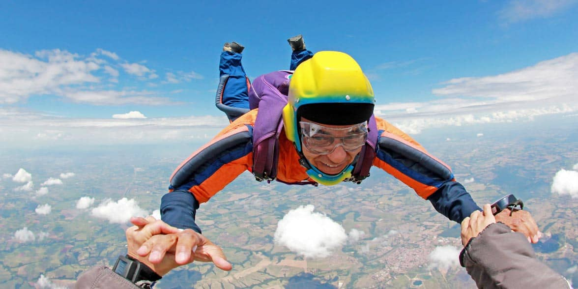 Photo of a senior skydiving