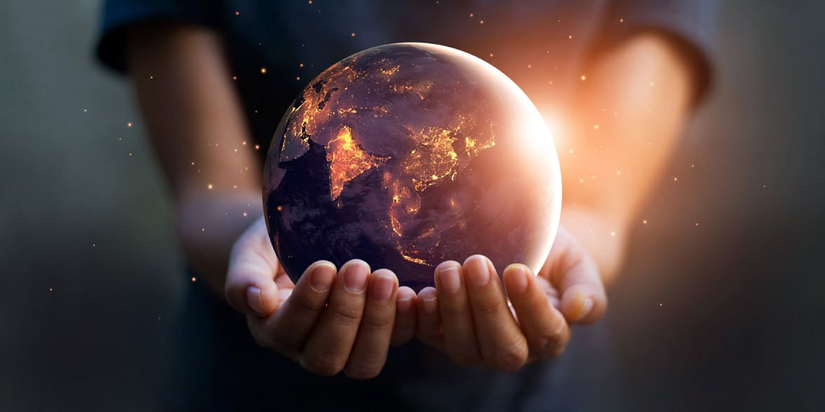 Photo of a man holding the world in his hands