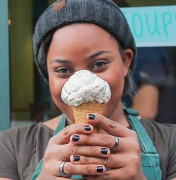 Photo of a woman holding an ice cream cone