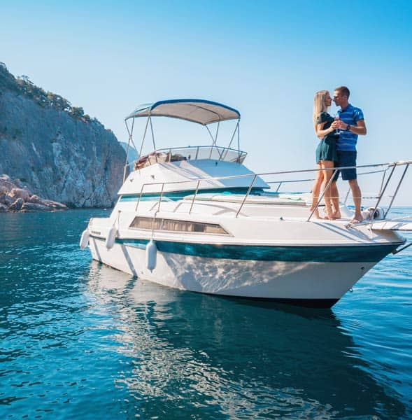 Photo of a couple on a yacht