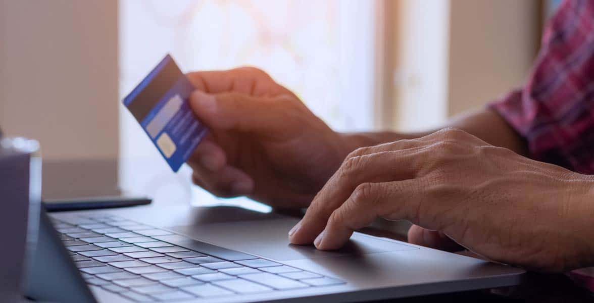 Photo of a man with a credit card