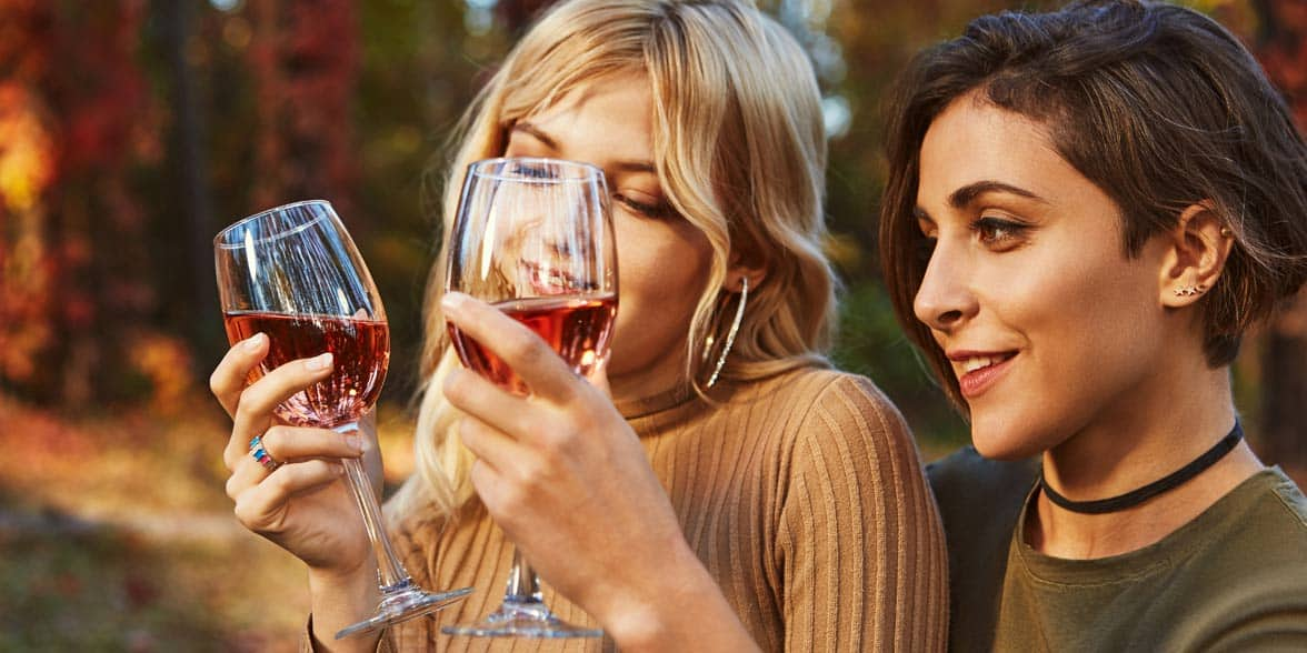 Photo of two women drinking wine