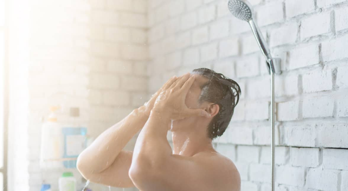Photo of a man showering