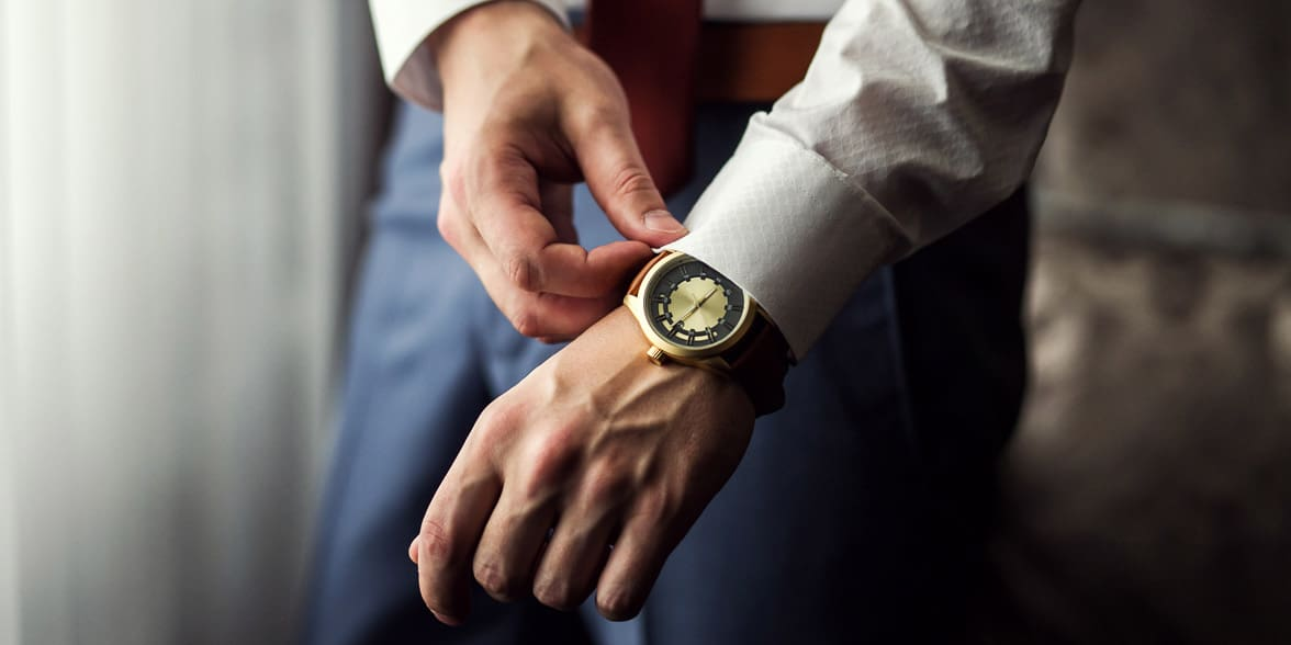 Photo of a man putting on a watch