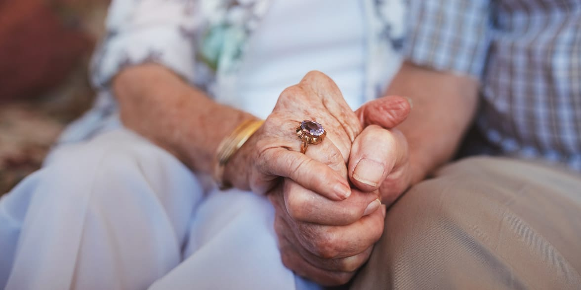 Photo of mature couple holding hands