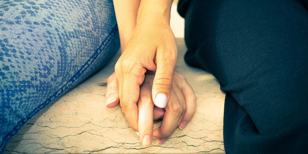 Photo of lesbian couple holding hands