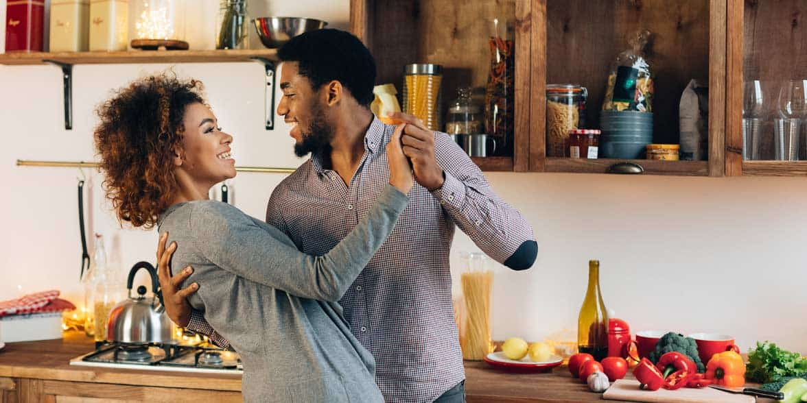 Photo of couple dancing in kitchen