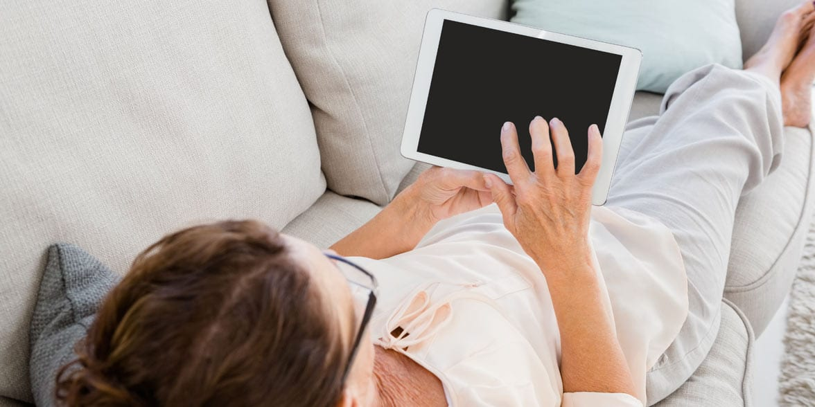 Photo of a woman on a tablet